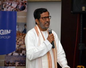 Baba speaking in front of poster 300x236 Baba speaking in front of poster